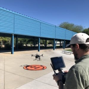 Tim Janes launching a drone