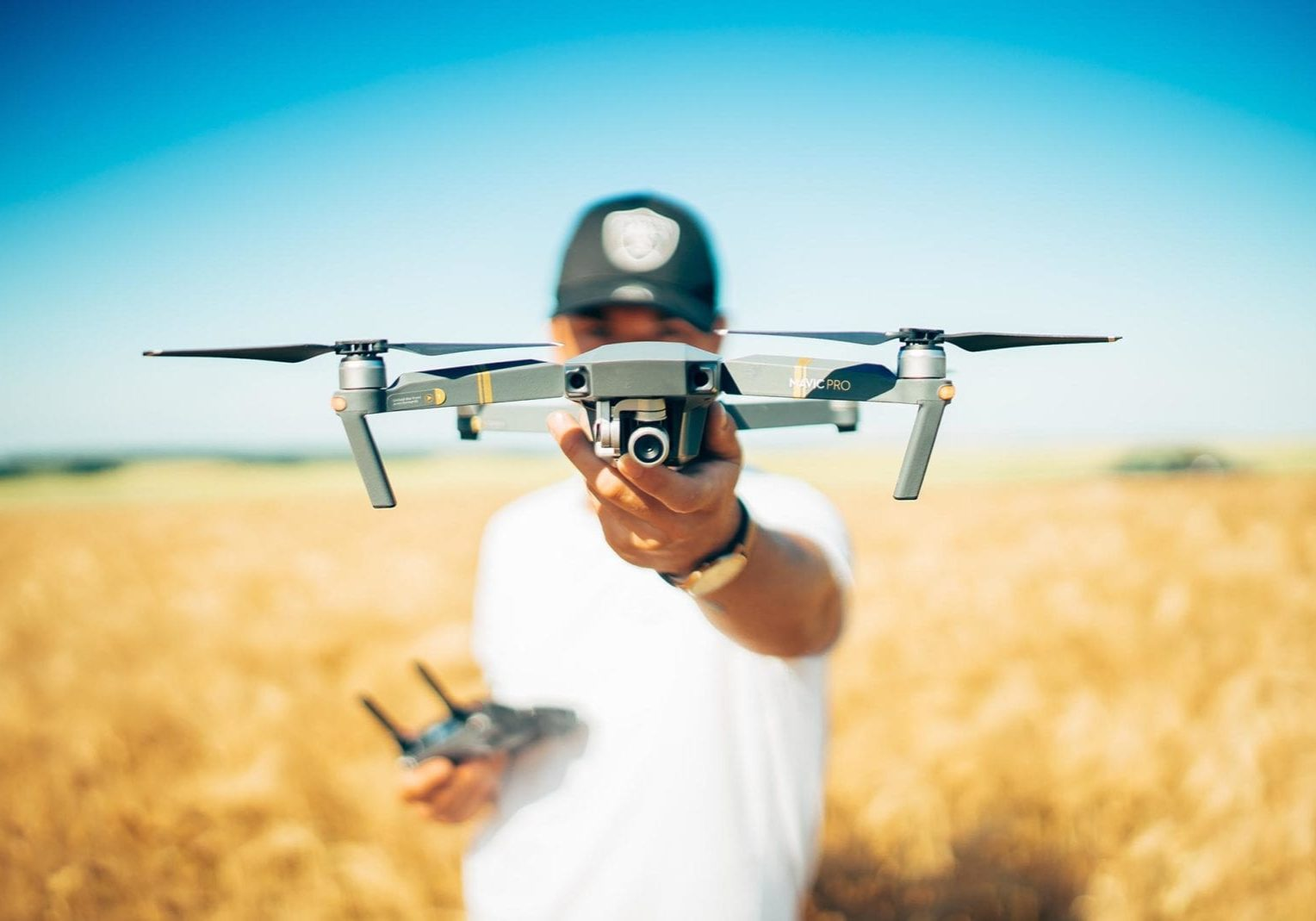 student pilot holding drone and remote control